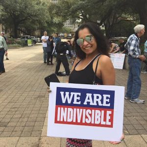 We Are Indivisible lady with sign picture